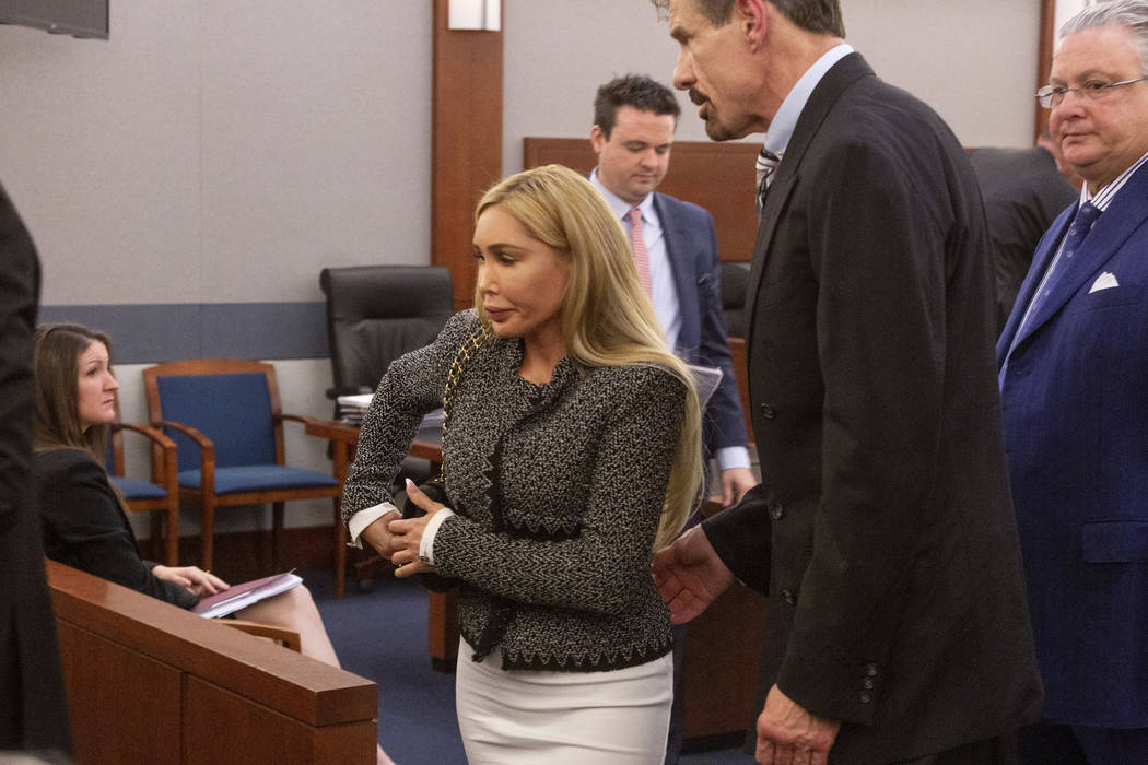 Ashley Fargo, left, and boyfriend Henry Nicholas III exit the courtroom after pleading guilty t ...