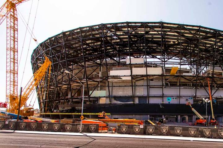 Crews install glass panes along the lower level of Allegiant Stadium on Tuesday, Sept. 10, 2019 ...