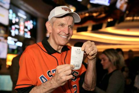 "Jim ""Mattress Mack"" McIngvale holds his ticket after making a $3.5 million wager to win $7. ..."
