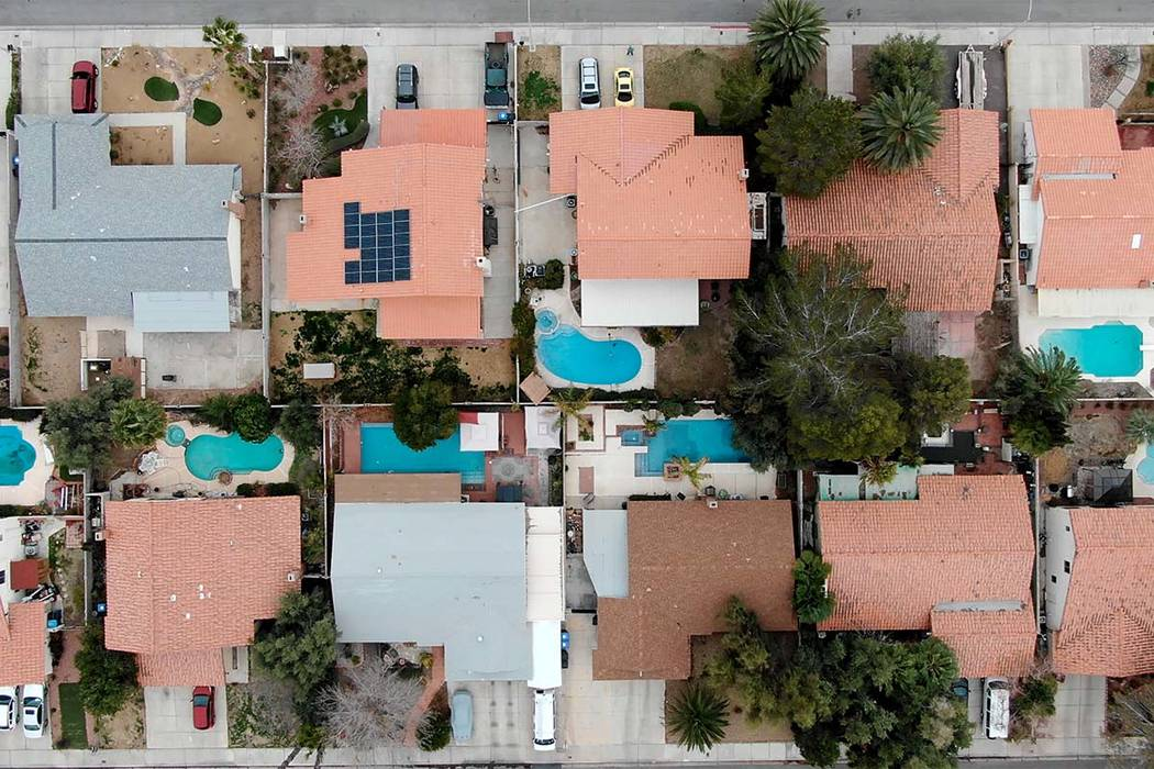 Aerial view of homes with swimming pools near Navarre Lane and Muchacha Drive in Henderson, Nev ...