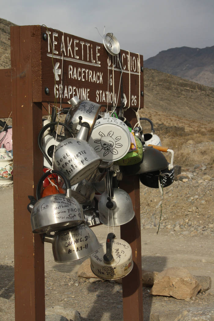 Many visitors bring hand-decorated tea kettles to leave at Teakettle Junction along Racetrack R ...
