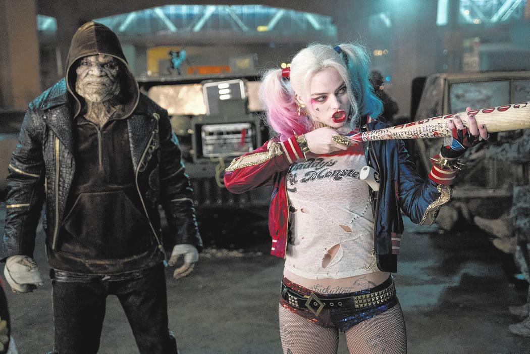 "Adewale Akinnuoye-Agbaje as Killer Croc and Margot Robbie as Harley Quinn in ""Suicide Squad."" ..."