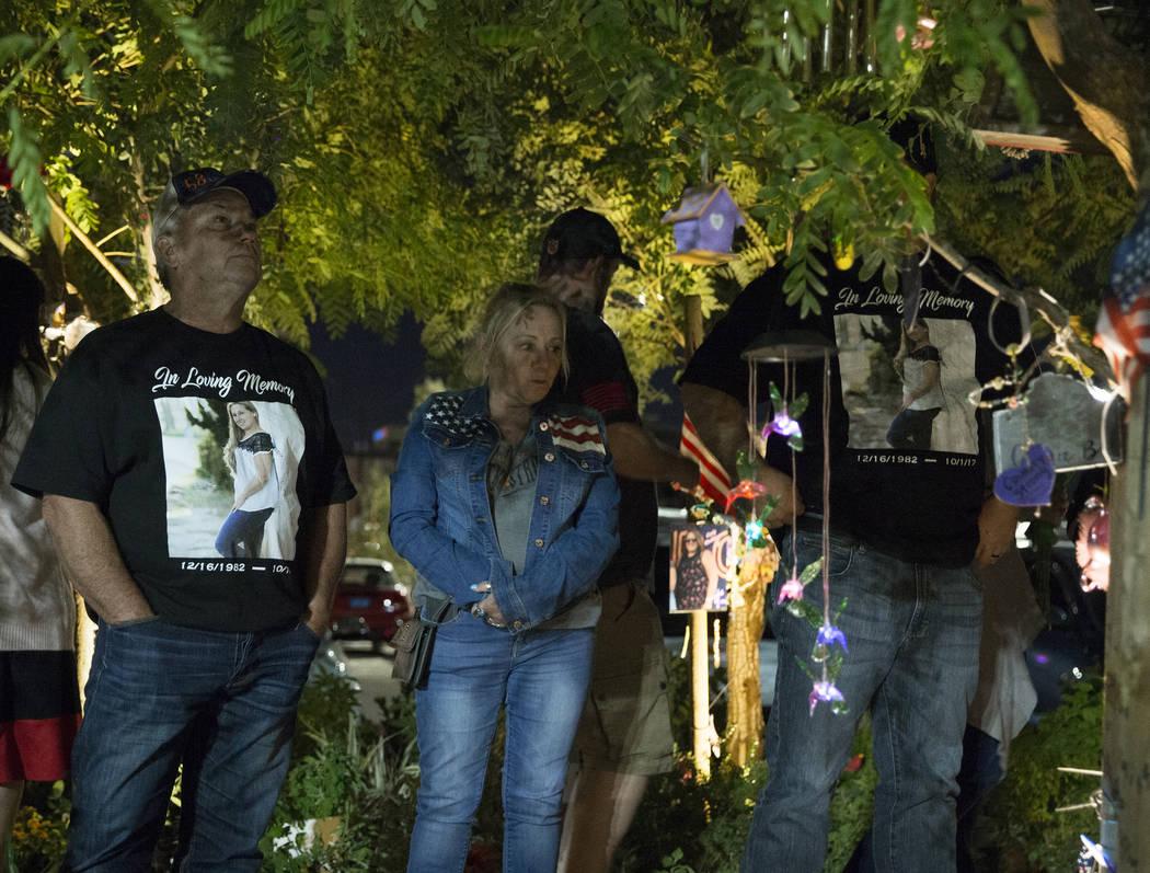 Rick Barnette, left, and Cindy Foster walk through the Las Vegas Community Healing Garden befor ...