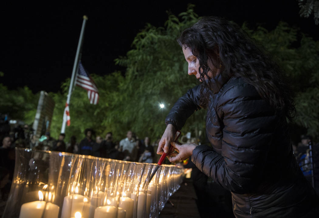 Mauricia Baca lights candles honoring the 58 victims of the Route 91 Harvest festival shooting ...