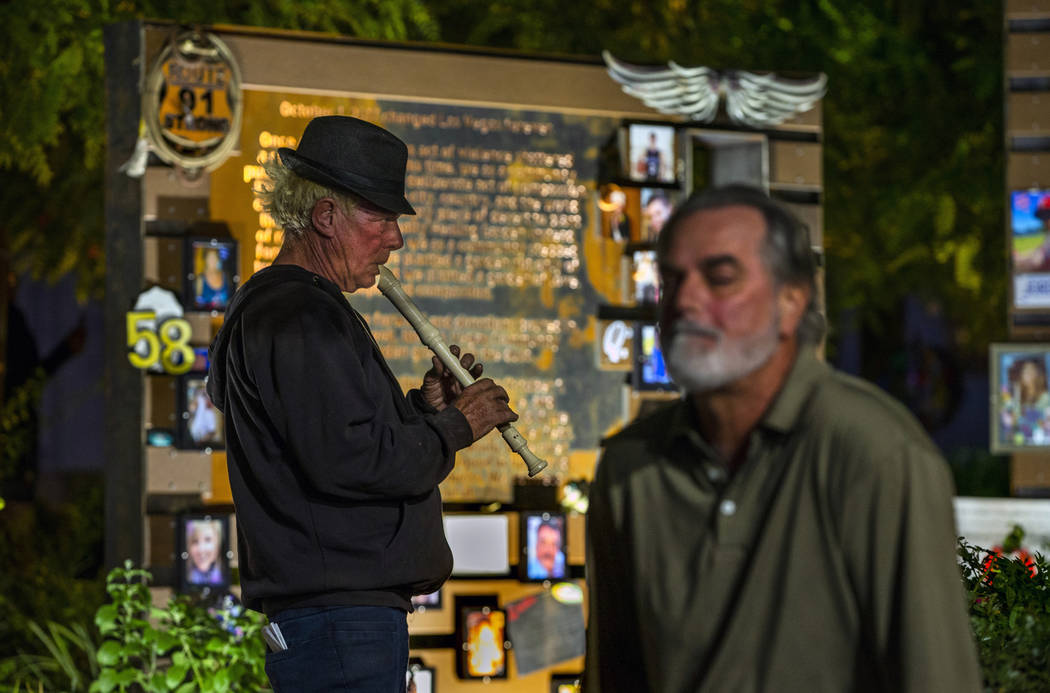 Tod Mainzer, left, plays the recorder as visitors take time out at the Las Vegas Healing Garden ...