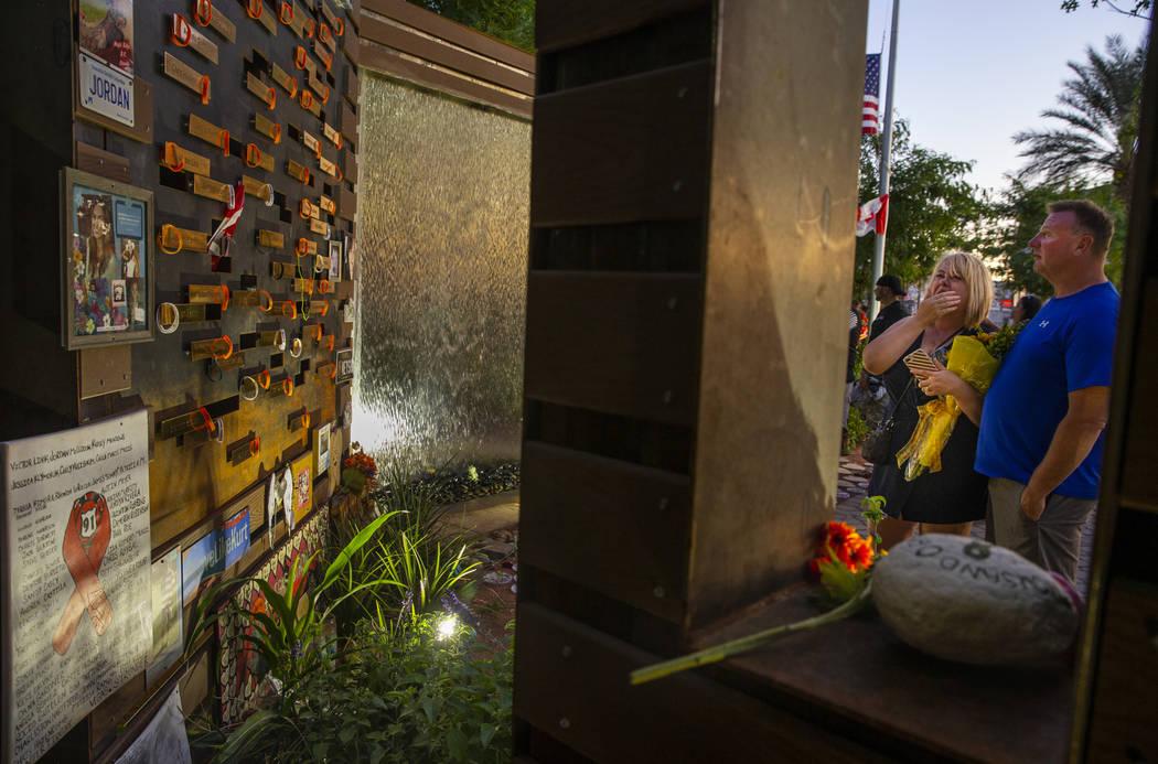 Char Teegarden, left, and husband Kurtiss pause at a remembrance wall at the Las Vegas Healing ...
