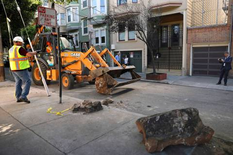 In this Monday, Sept. 30, 2019, photo, a San Francisco Public Works crew removes boulders from ...