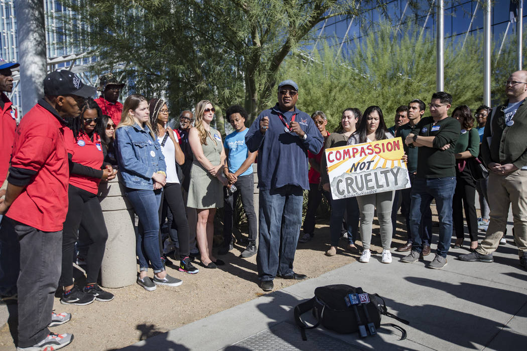 Thomas Randle-EL, co-founder and director of Straight From the Streets, addresses the media at ...