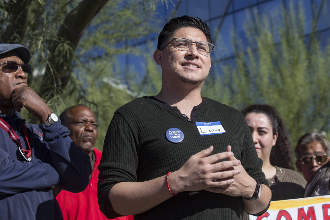 LaLo Montoya, political director of Make The Road Nevada, addresses the media at a protest agai ...