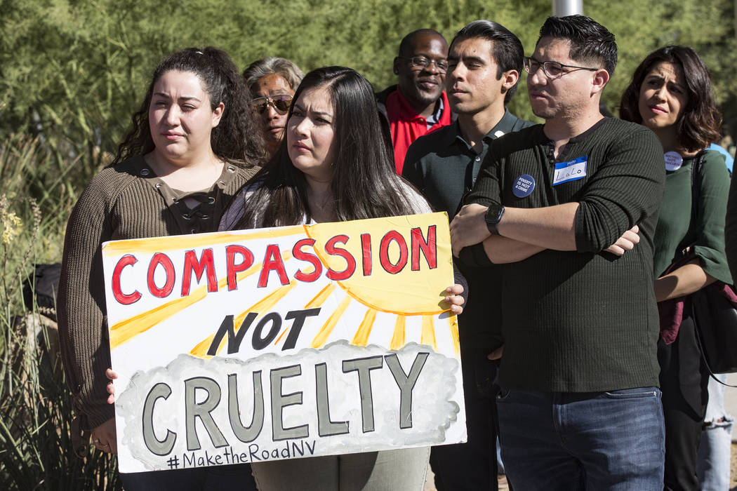 Blanca Macias, director of operations for Make The Road Nevada, holds a sign next to political ...