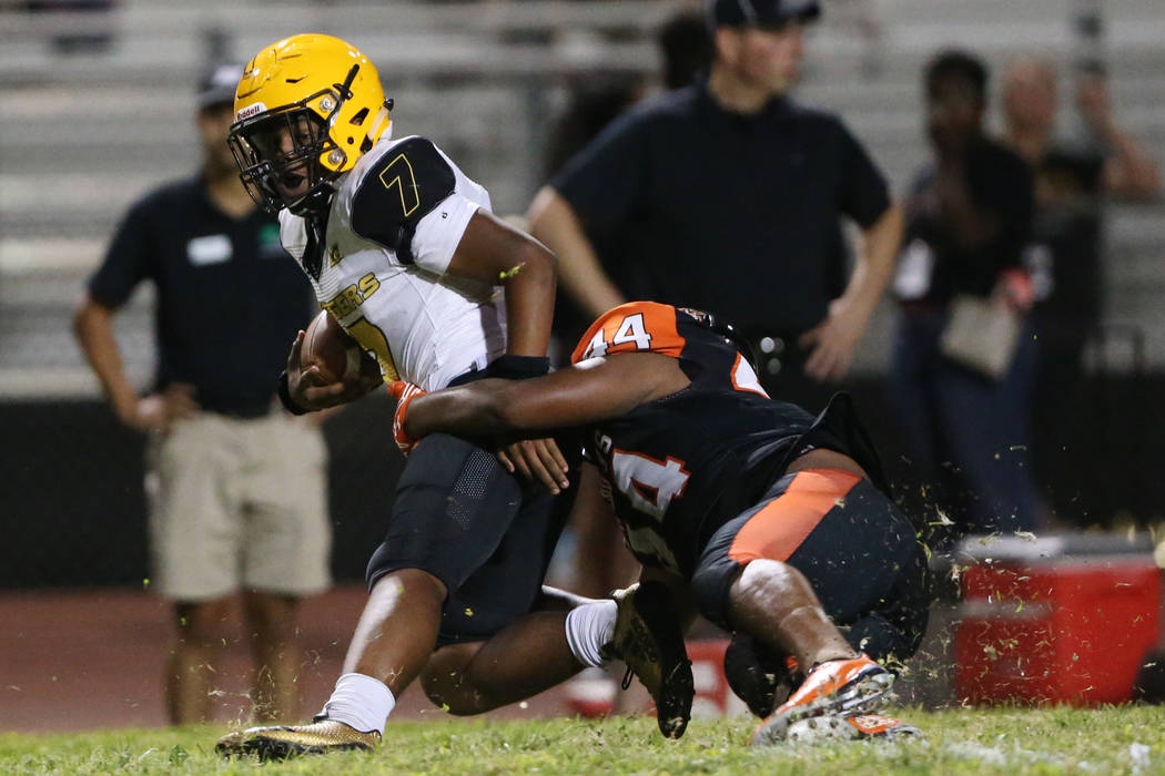 Clark's My'quel Johnson(7) is tackled by Chaparral's Robert Whitstone (44) in the second quarte ...