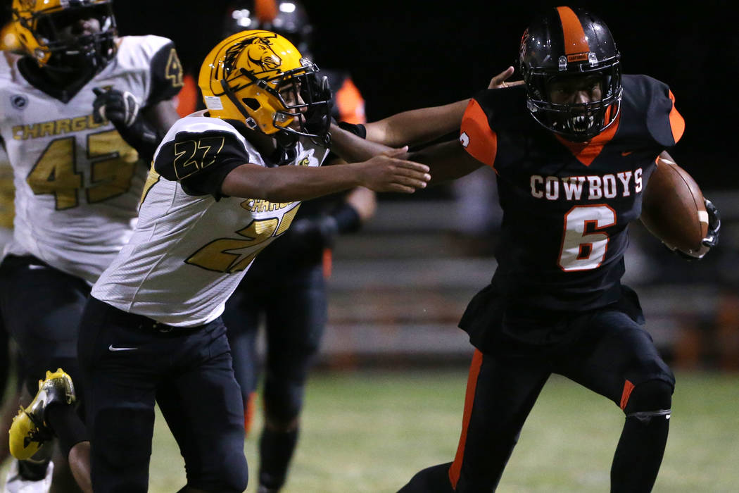 Chaparral's Al Caesar (6) runs the ball against Clark's Dominick Phillips (27) in the second qu ...