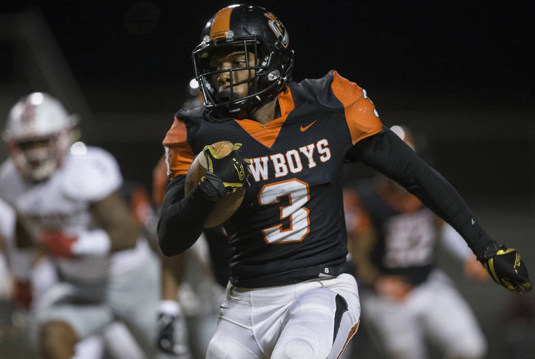 Chaparral senior running back Meshach Hawkins (3) sprints up field past Liberty defenders in th ...