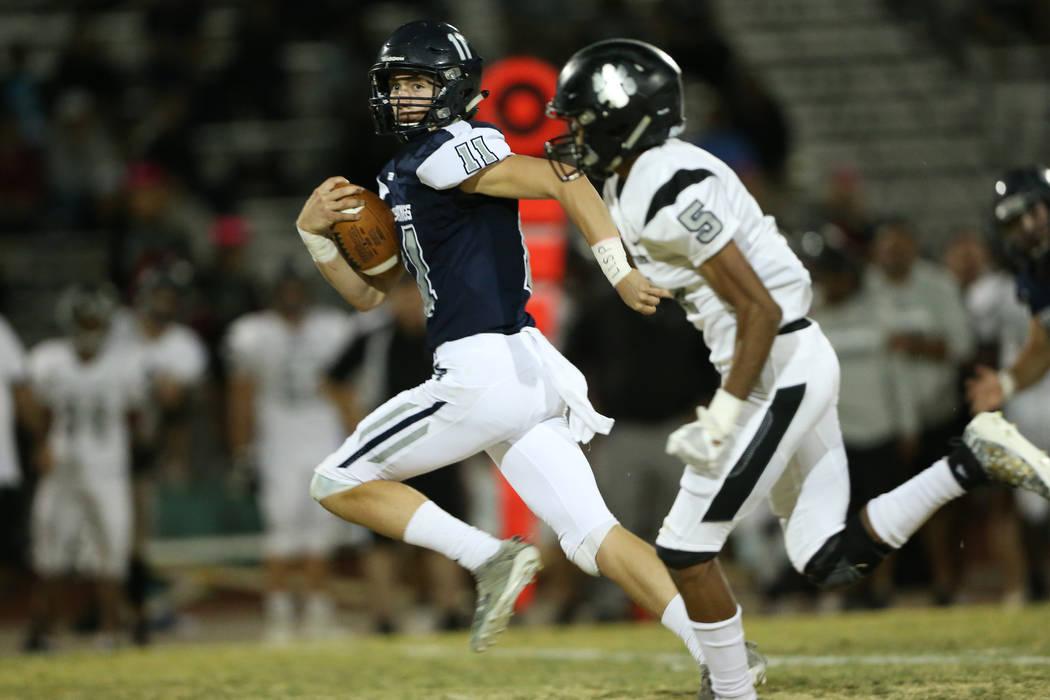 Shadow Ridge's quarterback Aiden Valenzuela (11) runs the ball for a touchdown with Palo Verde' ...