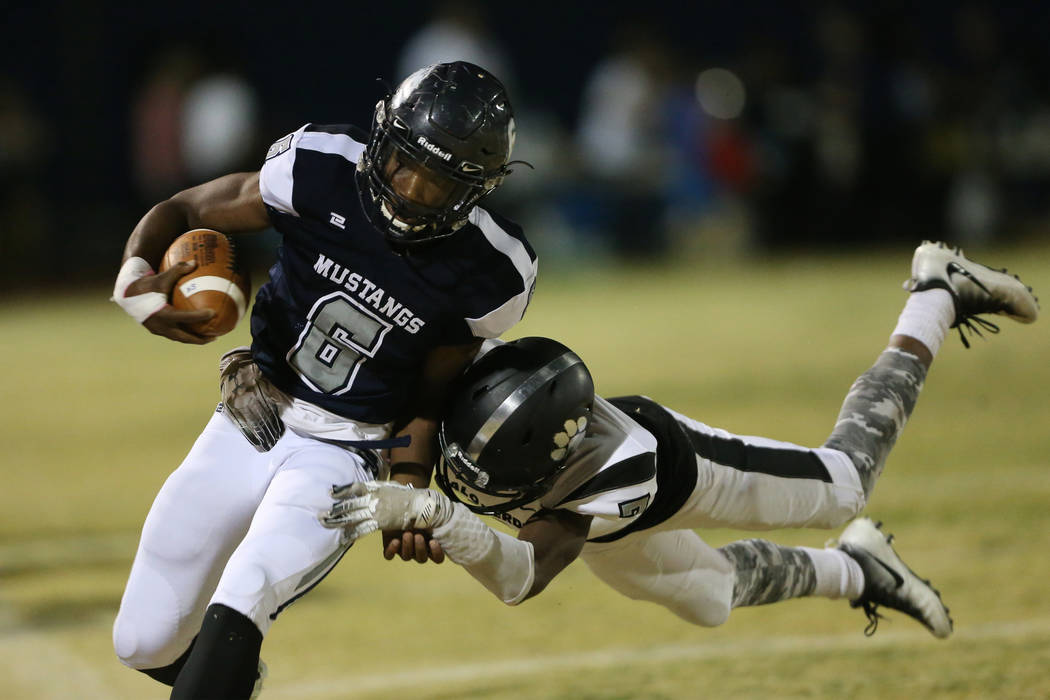 Shadow Ridge's Marrion Macklin-Thomas (6) is tackled by Palo Verde's Adrian Ellis (7) in the fi ...