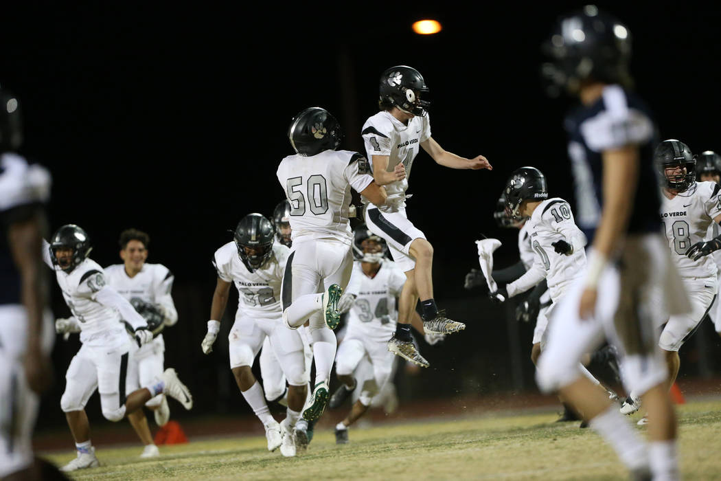 Players from Palo Verde including Bogdan Filipovic (50) and Joey Caifano (4) celebrate their wi ...