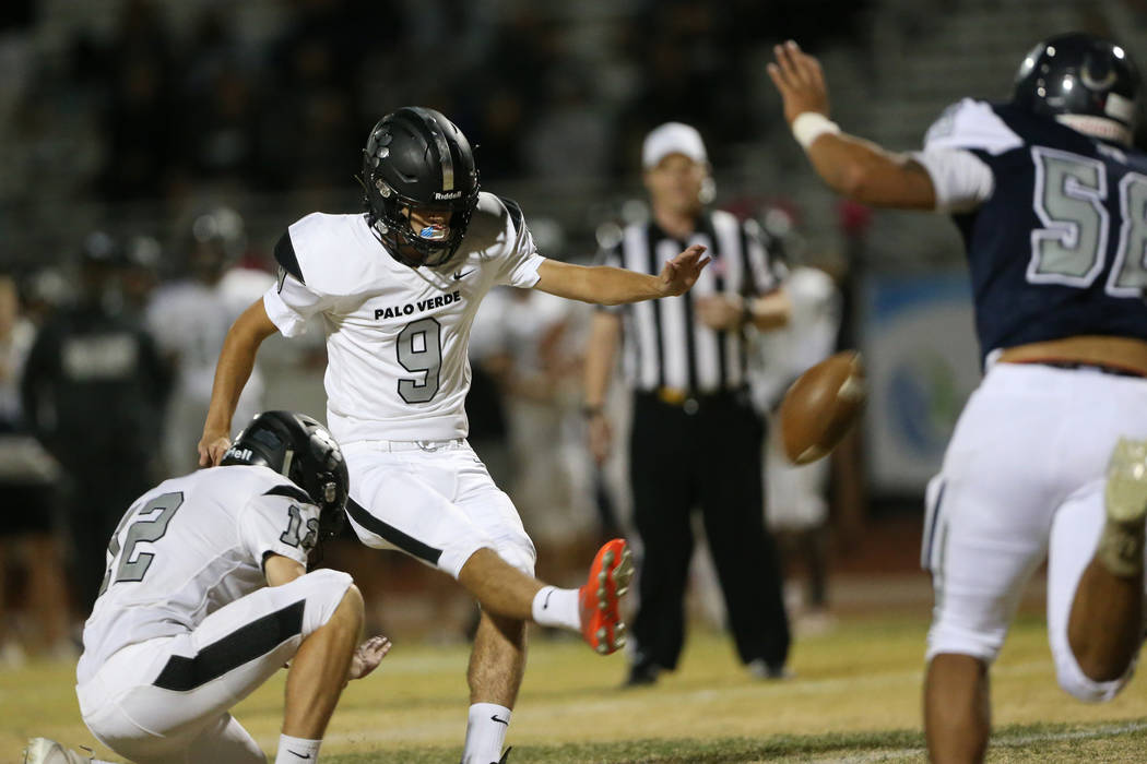 Palo Verde's Zach Moore (9) kicks the winning extra point of the game with Jacob Gosz-Siqueiros ...