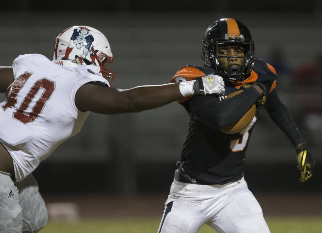 Chaparral senior running back Meshach Hawkins (3) is stopped in the backfield by Liberty sophom ...