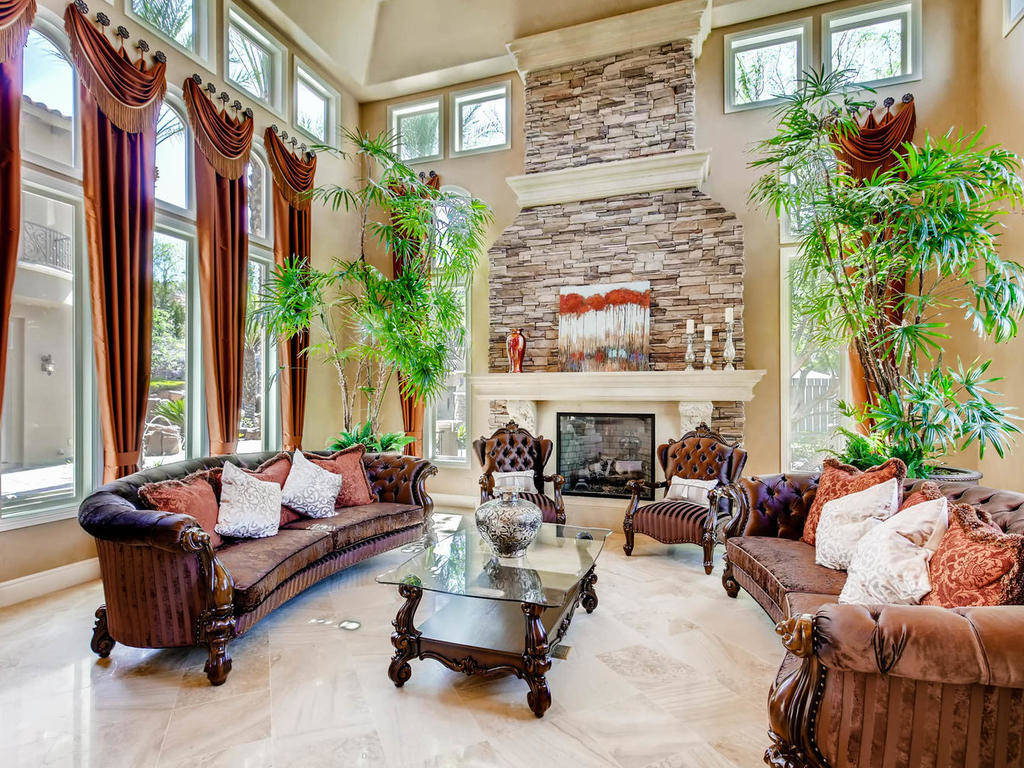 A fireplace is the center of the expansive living room.
