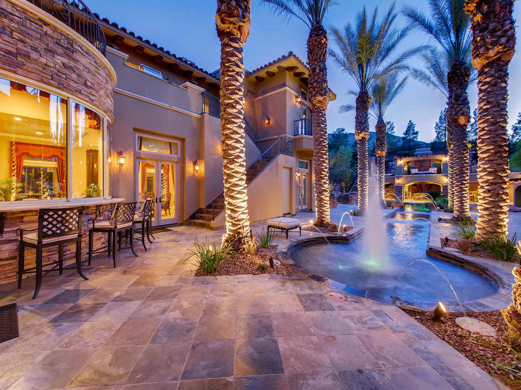 The home has a bar by the pool.