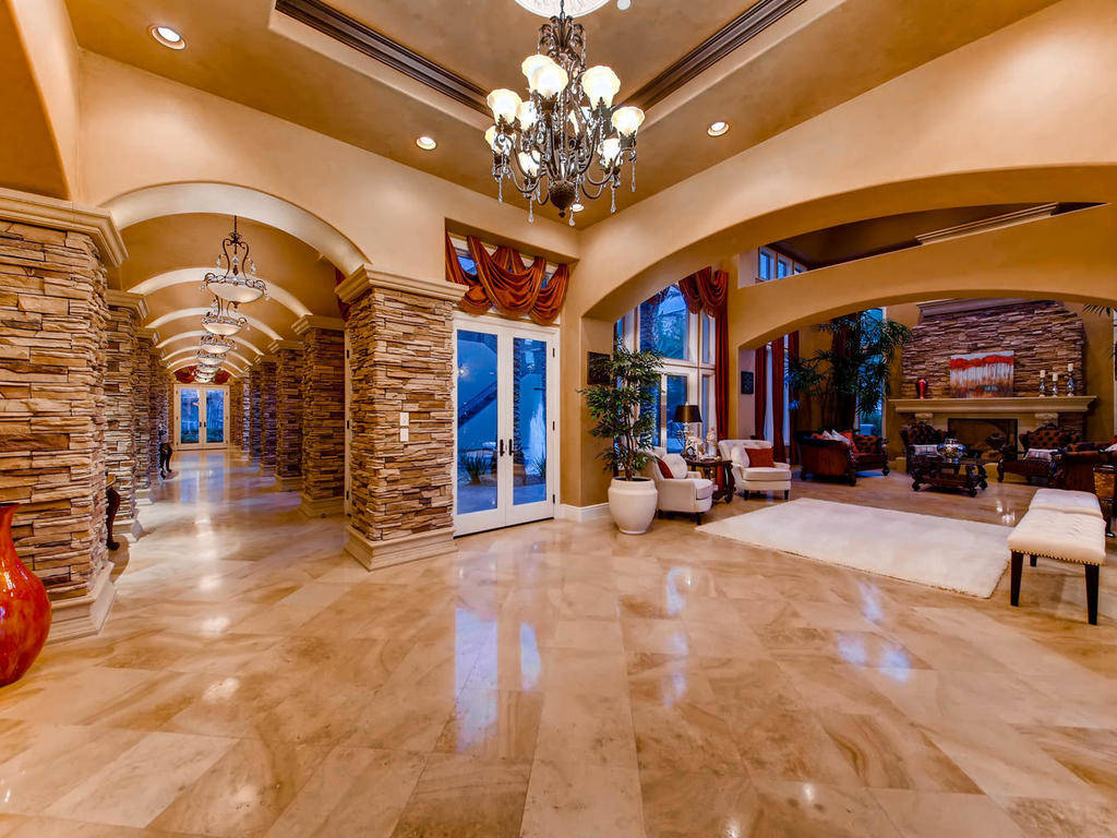 The estate showcases imported French limestone flooring, coffered ceilings and natural stone ac ...