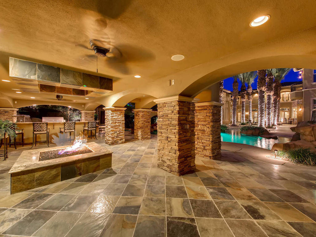 The resort-style backyard features a patio with fire pit.