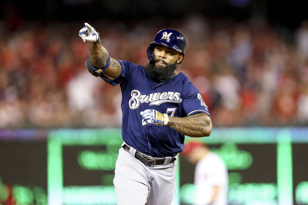 Milwaukee Brewers' Eric Thames gestures after hitting a solo home run during the second inning ...