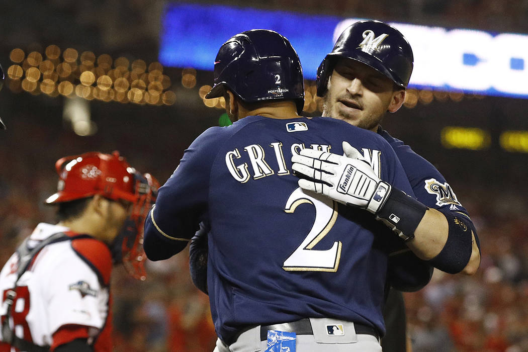 Milwaukee Brewers' Yasmani Grandal, right, celebrates with teammate Trent Grisham after batting ...