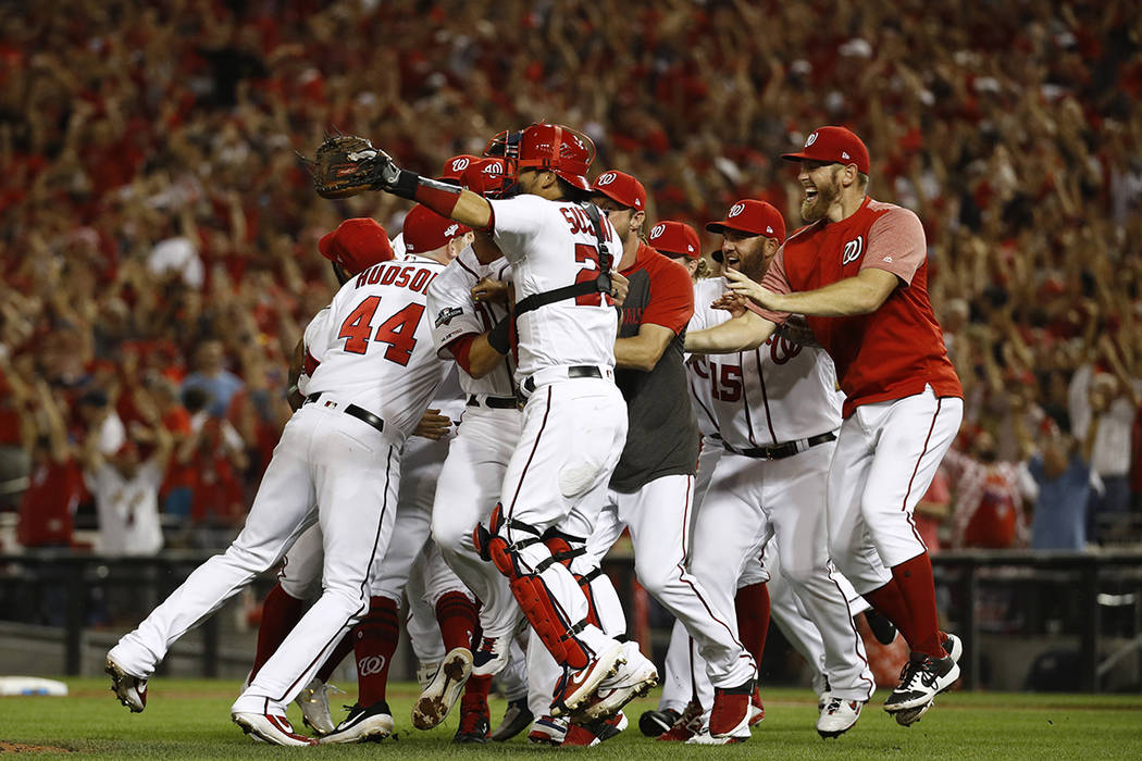 Members of the Washington Nationals celebrate after winning a National League wild-card basebal ...