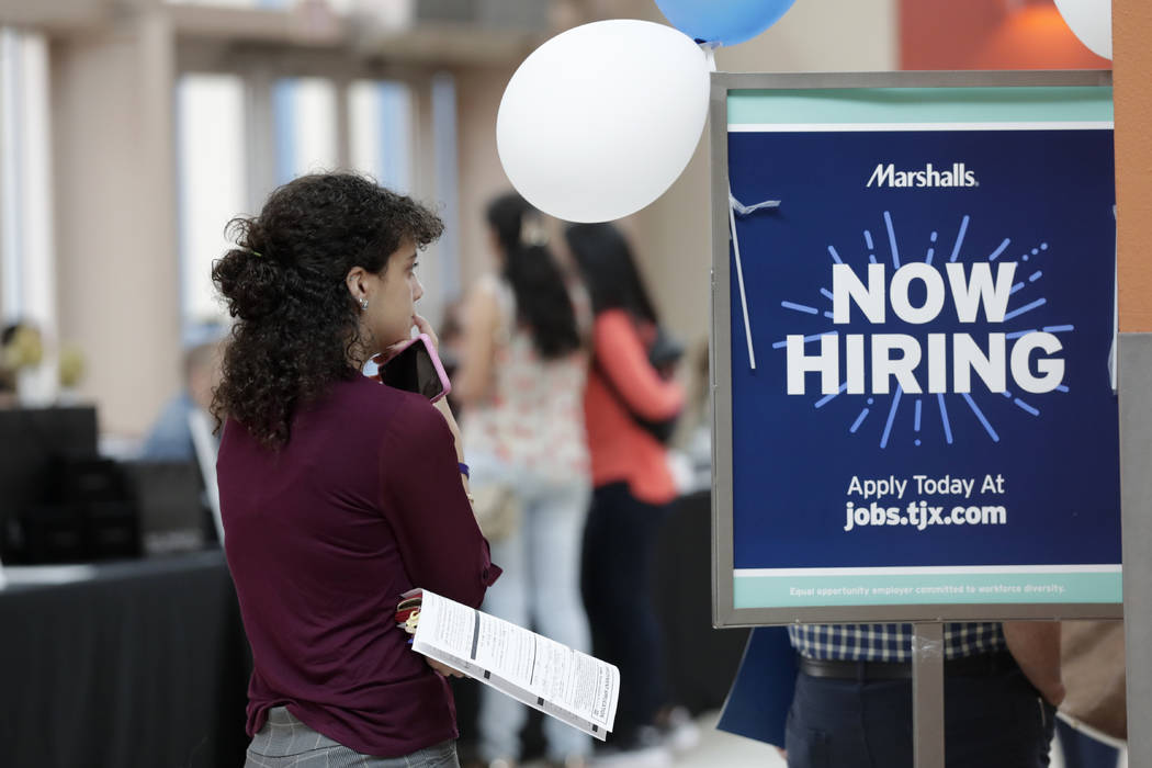 In a Tuesday, Oct. 1, 2019, photo, Daisy Ronco waits in line to apply for a job with Marshalls ...