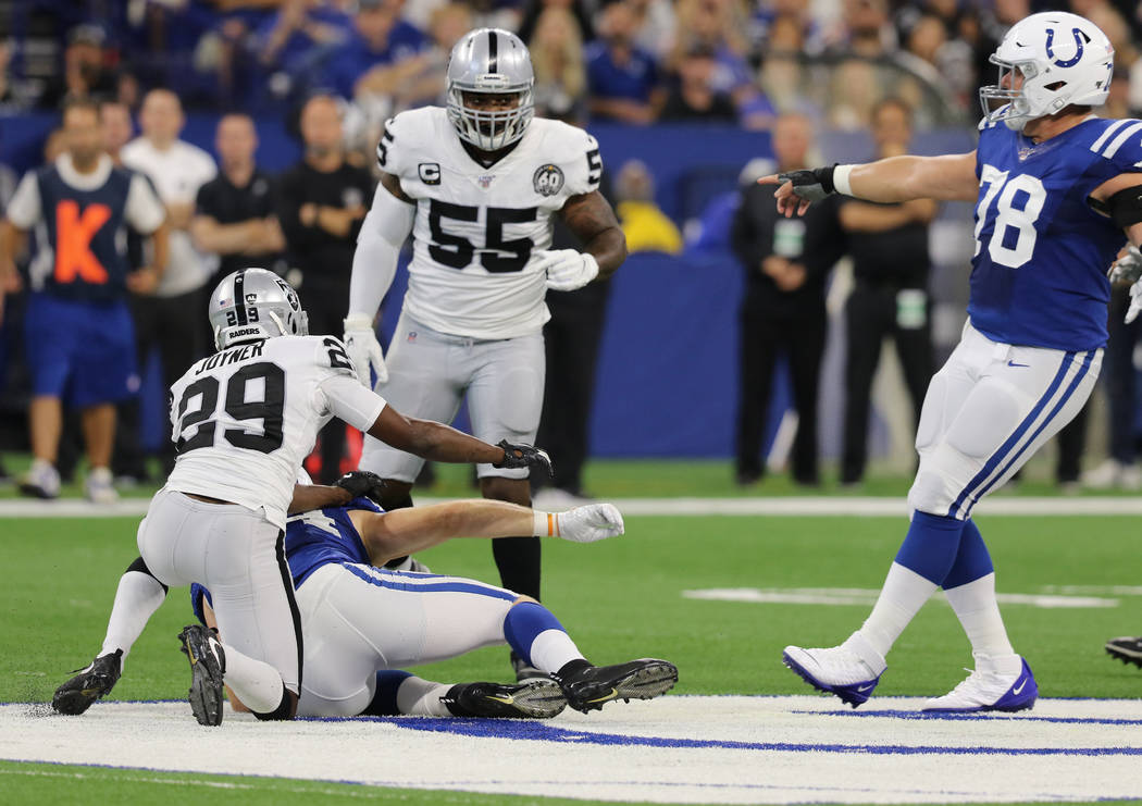 Indianapolis Colts center Ryan Kelly (78) points at Oakland Raiders outside linebacker Vontaze ...