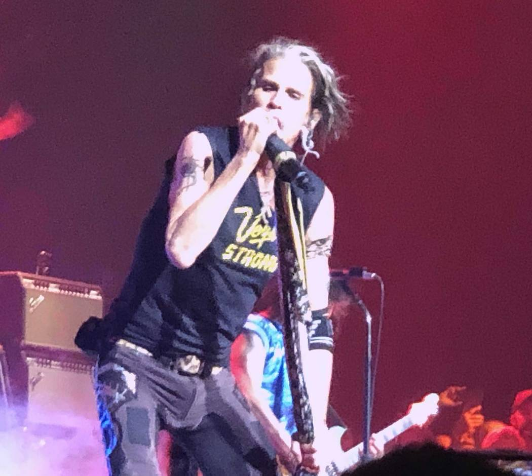 """Steven Tyler performs """"Come Together"""" in a T-shirt honoring Oct. 1 shooting victims at Aerosmit ..."""