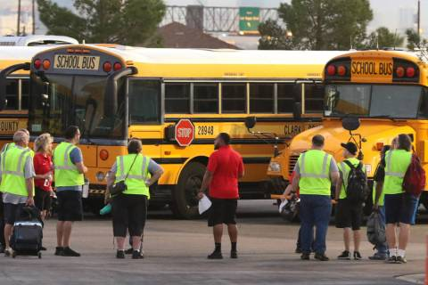 Clark County School District's bus drivers arrive at the Wallace Transportation Yard during the ...