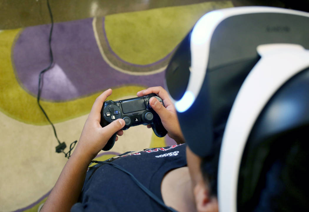 Alexis, 14, Henderson, plays Playstation 4 VR at the teen center at Green Valley Library in Hen ...