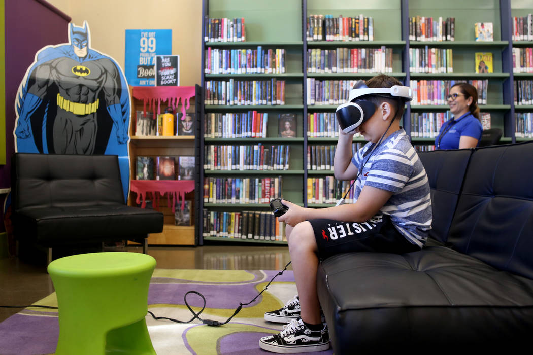 Dominic Giorgi, 10, Henderson, plays a PlayStation 4 VR game in the teen center at Green Valley ...