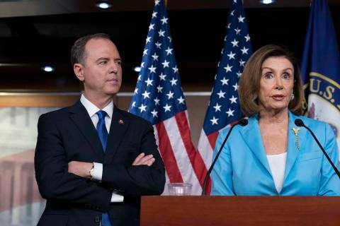 Speaker of the House Nancy Pelosi, D-Calif., is joined by House Intelligence Committee Chairman ...