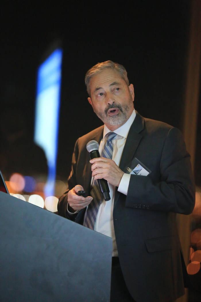 John Restrepo, of RCG Economics Las Vegas, brought global and national economic news down to th ...