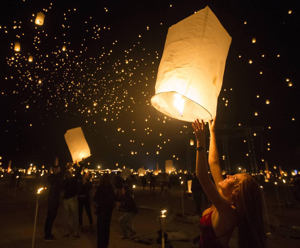 Delaney Evans releases her lantern during the RiSE Lantern Festival at Jean Dry Lake Bed on Fri ...