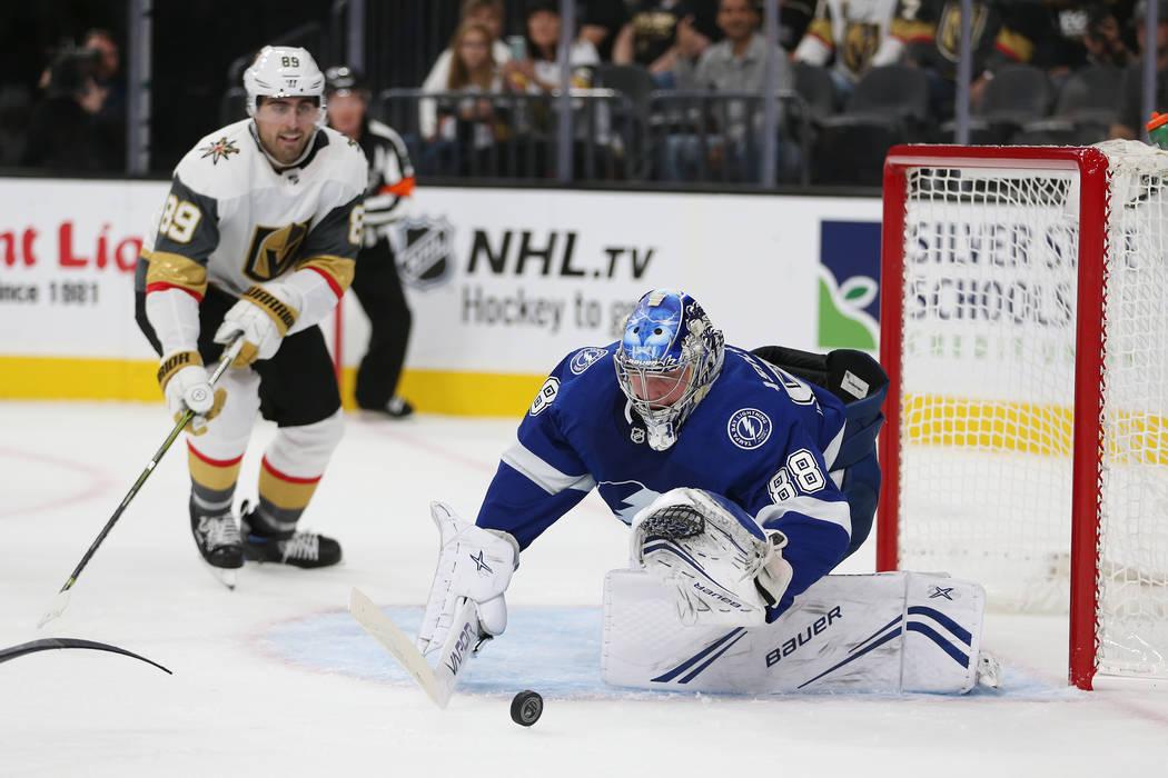 Tampa Bay Lightning goaltender Andrei Vasilevskiy (88) defends a shot against Vegas Golden Knig ...