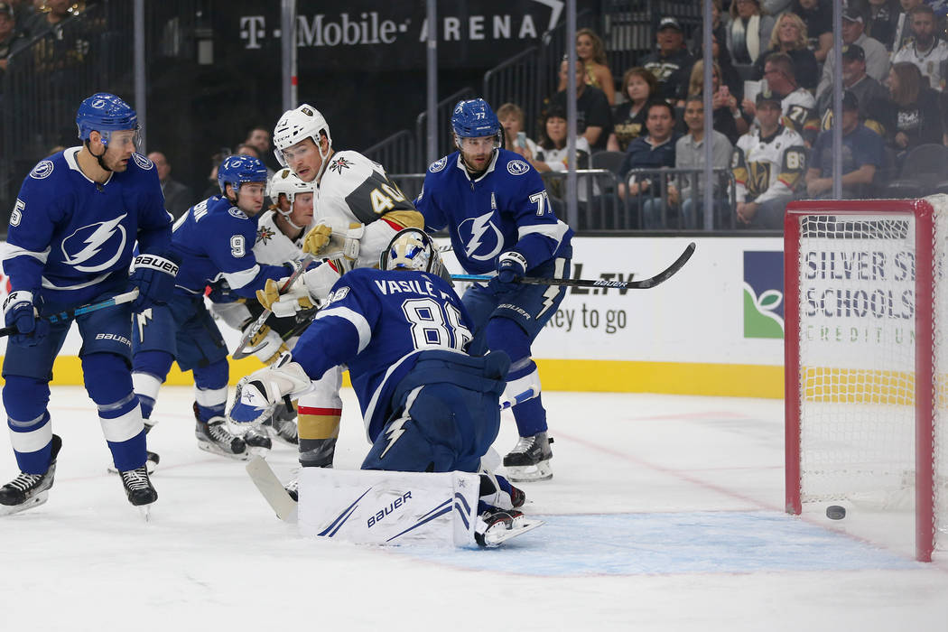 A shot by Vegas Golden Knights defenseman Shea Theodore (27) goes in for a score against Tampa ...