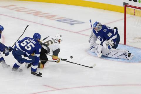 Vegas Golden Knights defenseman Colin Miller (6) is fouled by Tampa Bay Lightning defenseman Br ...