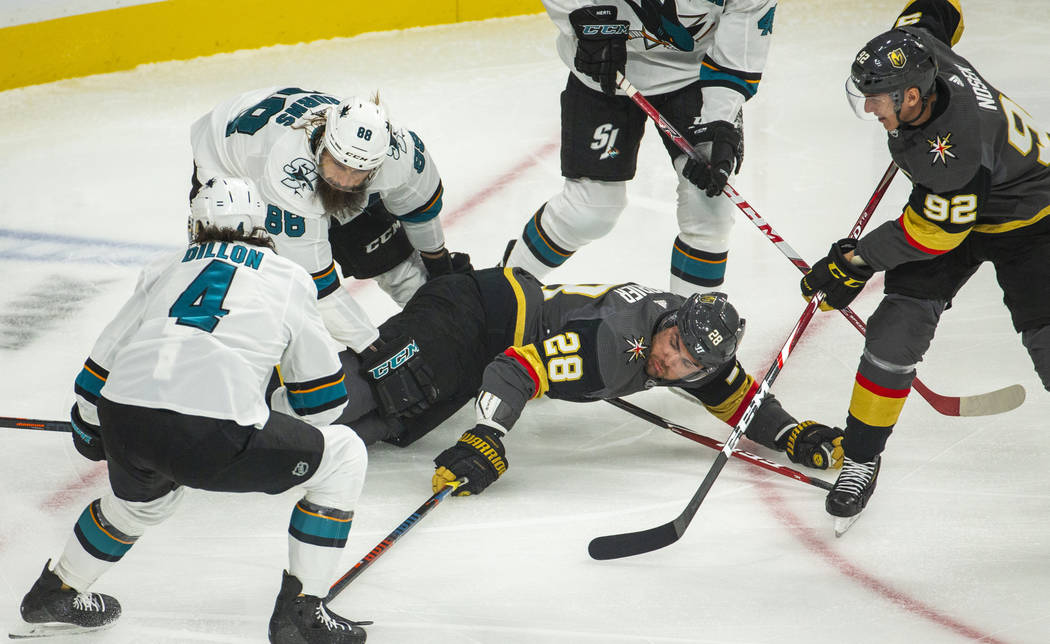 Vegas Golden Knights left wing William Carrier (28) attempts to hit the puck after being taken ...