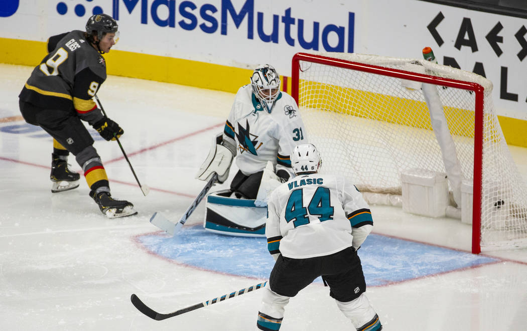 Vegas Golden Knights center Cody Glass (9) scores on San Jose Sharks goaltender Martin Jones (3 ...