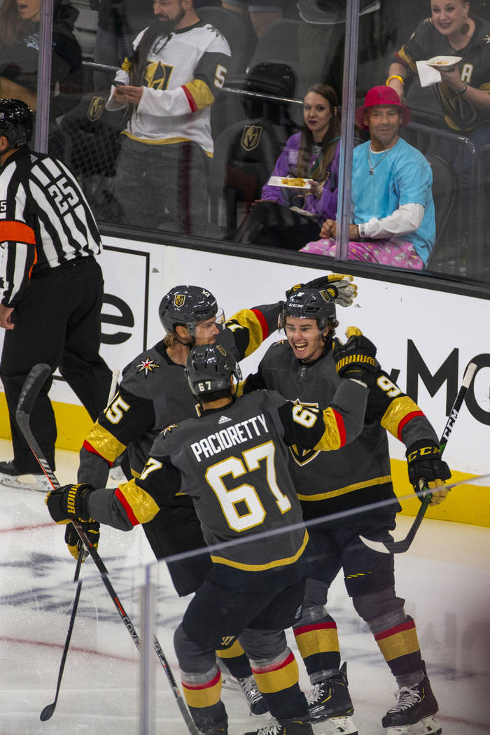 Vegas Golden Knights center Cody Glass (9, right) celebrates his score on San Jose Sharks goalt ...