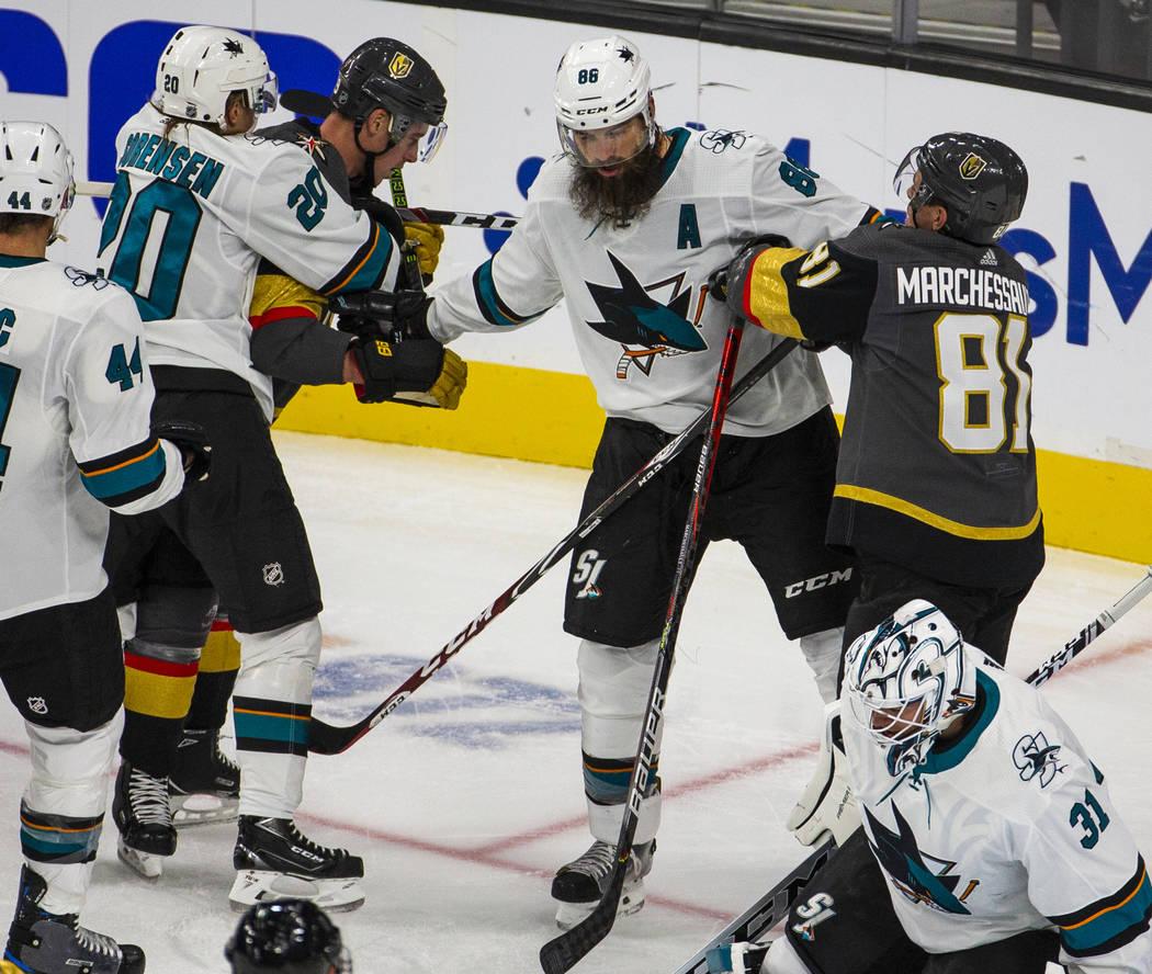 San Jose Sharks defenseman Brent Burns (88, center) begins to fight with Vegas Golden Knights c ...