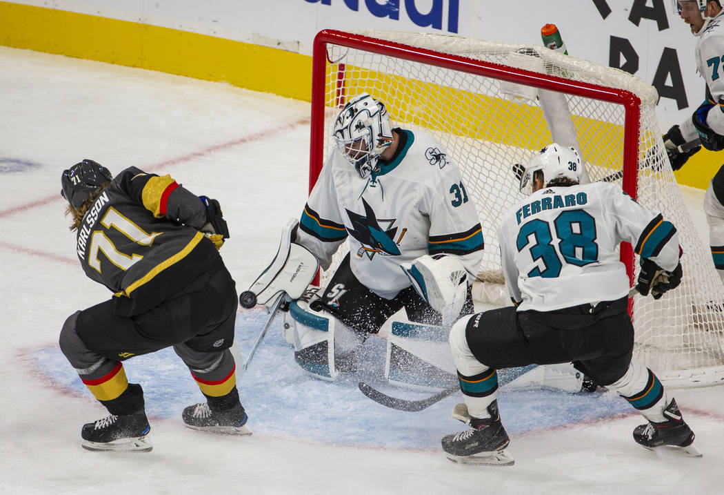 Vegas Golden Knights center William Karlsson (71) takes a shot on San Jose Sharks goaltender Ma ...