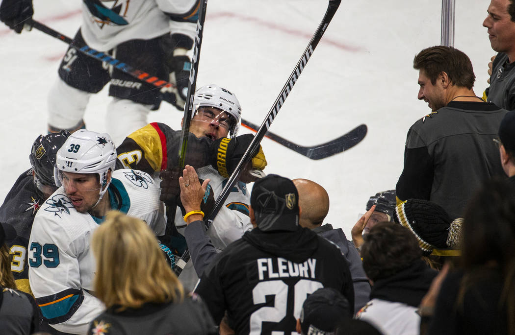 San Jose Sharks right wing Timo Meier (28, right) is punched in the face by Vegas Golden Knight ...