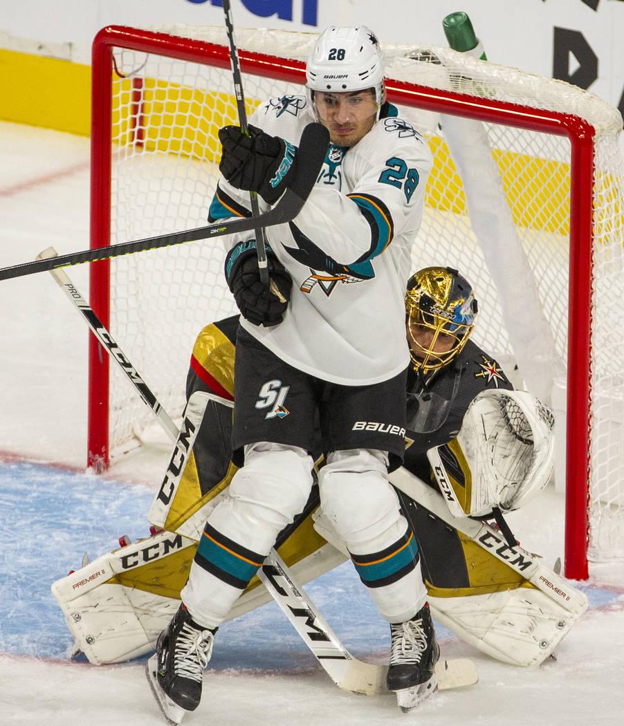 San Jose Sharks right wing Timo Meier (28) backs into Vegas Golden Knights goaltender Marc-Andr ...