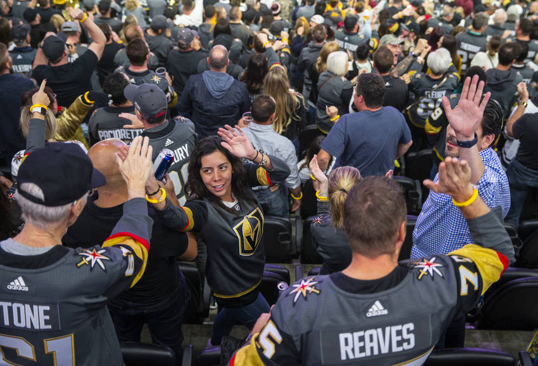 Vegas Golden Knights fans celebrate another goal over the San Jose Sharks during the third peri ...