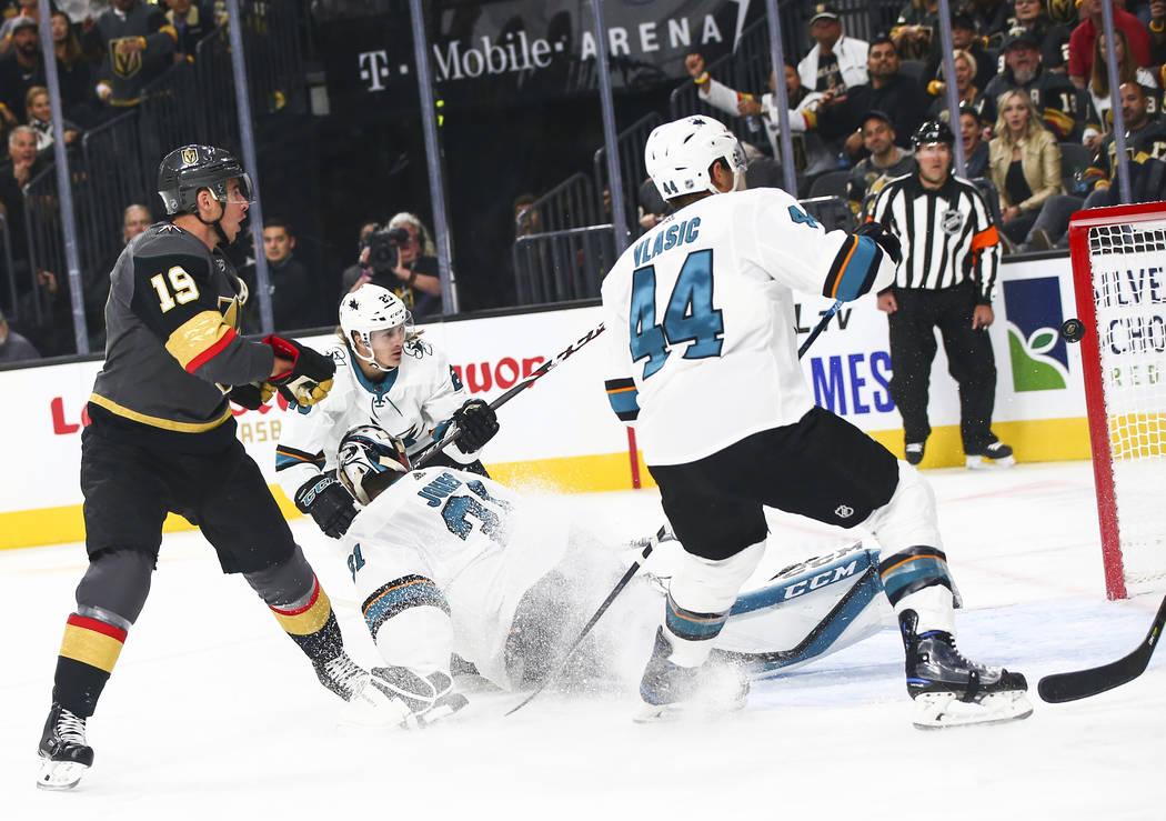 Golden Knights' Reilly Smith (19) sends the puck past San Jose Sharks goaltender Martin Jones ( ...